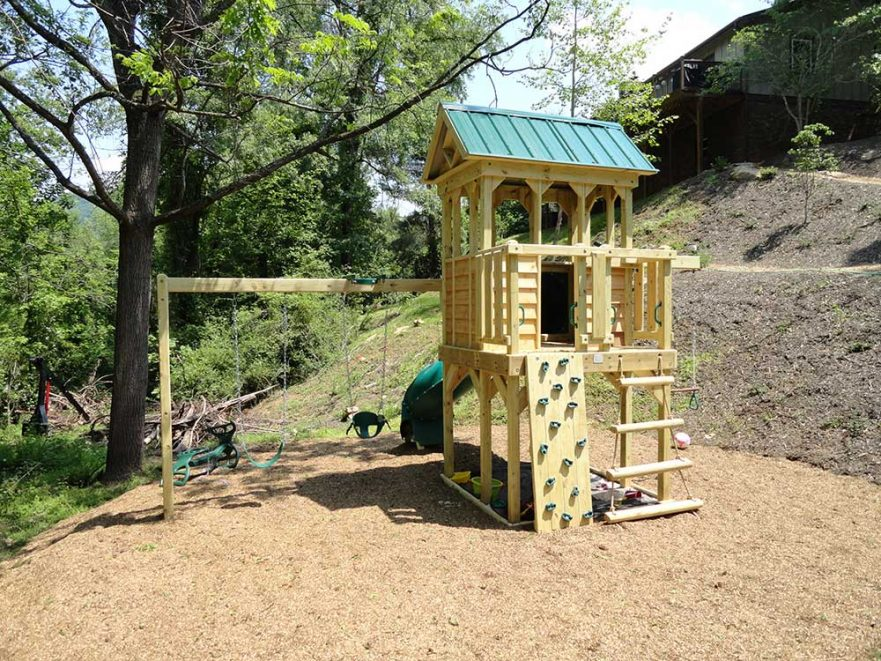 Fort With Log Climber Rock Wall and Swings
