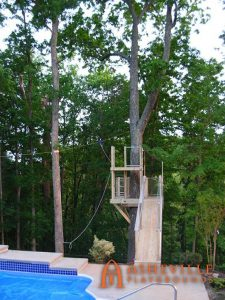 Tree Deck with Zip Line Running Over the Pool - Asheville Playgrounds