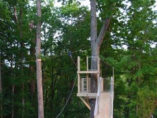 Tree Deck with Zip Line Over Pool