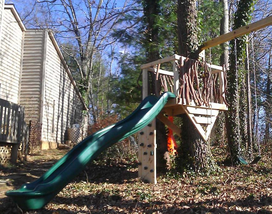Small Rustic Tree Deck Swings and Slide