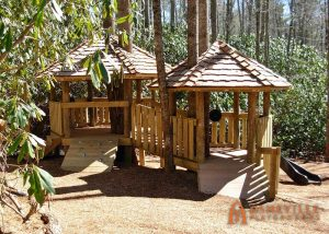 Toddler treehouse with cedar shake roof. Built for the Southcliff Community in Fairview, NC - Asheville Playgrounds